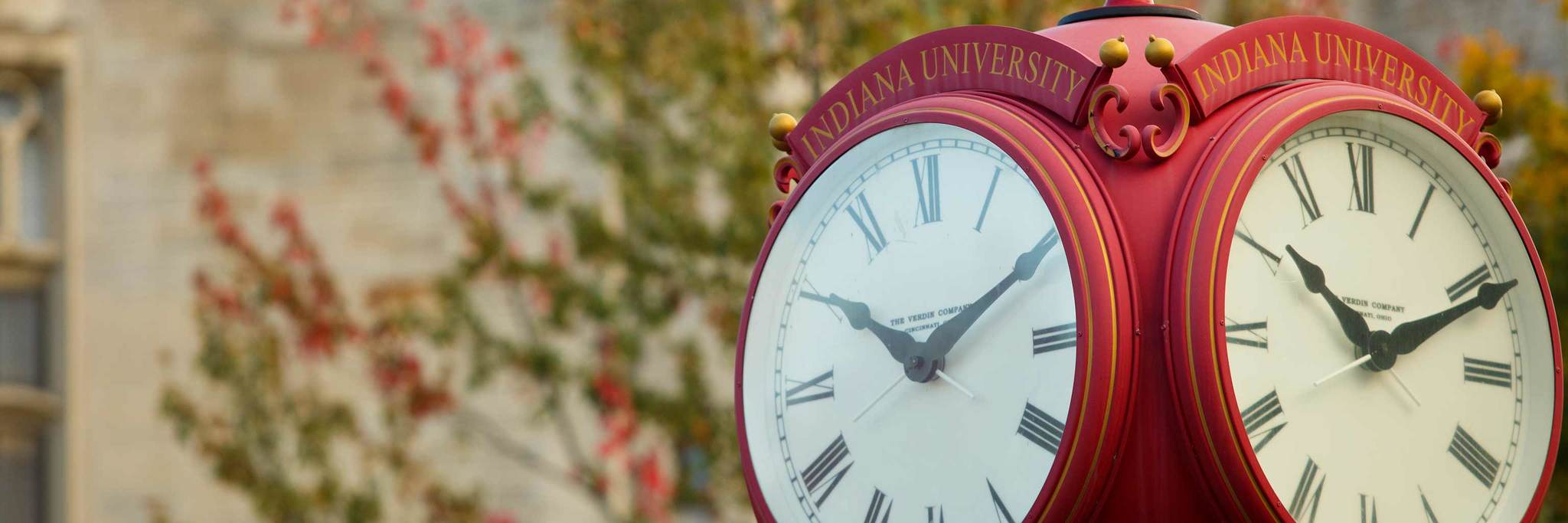 "A close-up of a red Indiana University clock illustrates the ""always + forward"" mission of ISCA."