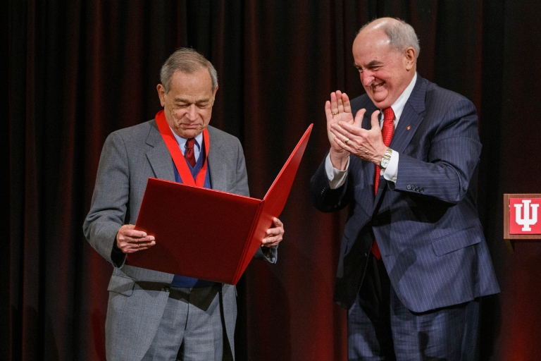 IU President McRobbie presents award book to Alvin Rosenfeld